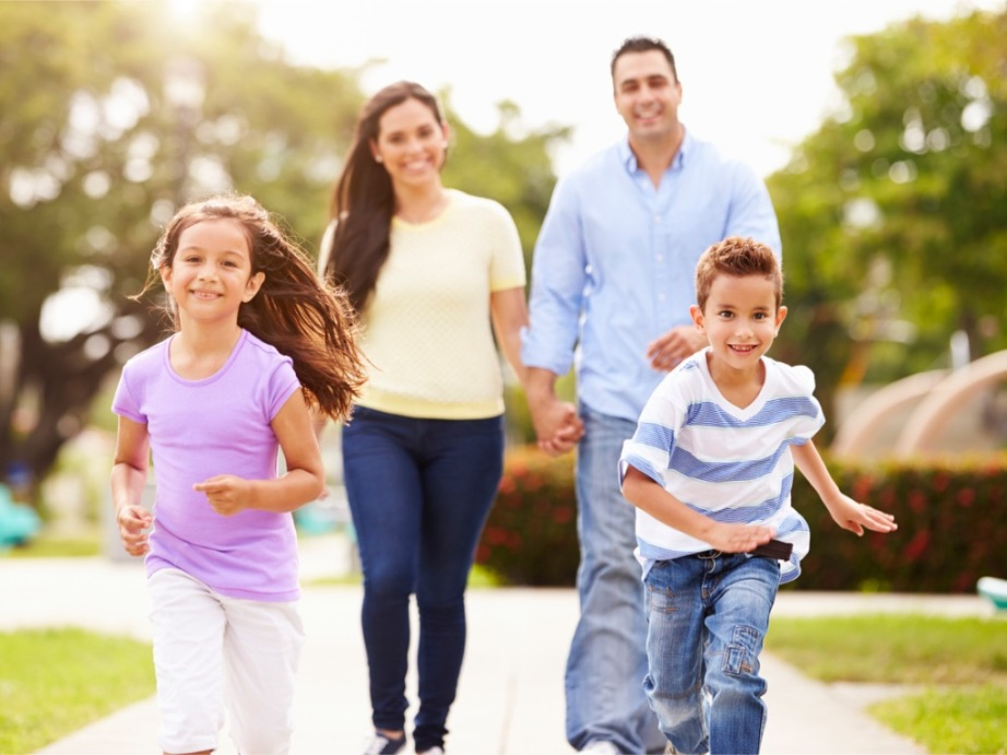 hispanic-family-walking-in-park-together-picture-id514134693